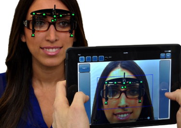 Lady with optikam on glasses and an ipad viewing them