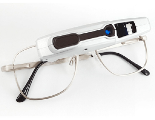Eyeglasses with a visual field expander across the lenses
