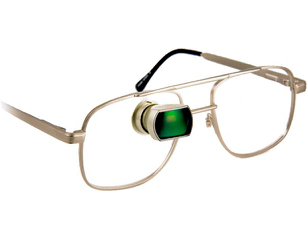 Gold glasses with a green visual field expsnder on the left lens